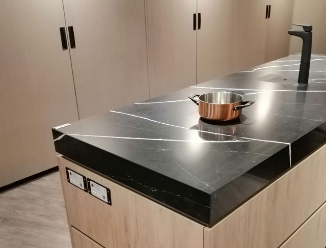 Undercounter induction units covered with artificial stone